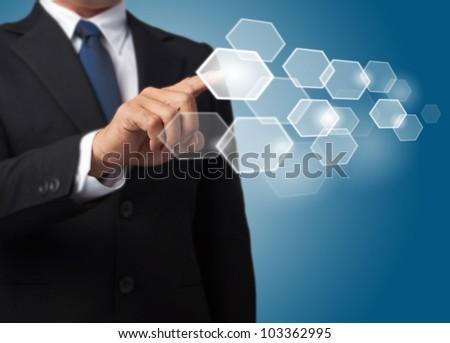 business man push a hexagonal touch screen button - stock photo