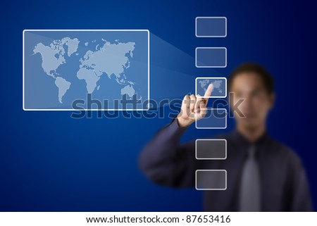 business man push a touch screen button to enlarge world map