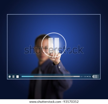 business man push pause button on touch screen to suspend video clip - stock photo