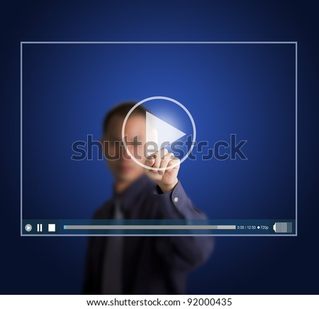 business man push start button on touch screen to run video clip - stock photo