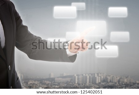 Business man pushing a button on a touch screen interface