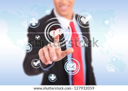 business man pushing a chat button ona futuristic interface - stock photo