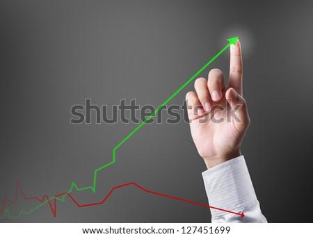 Business man pushing a graph - stock photo