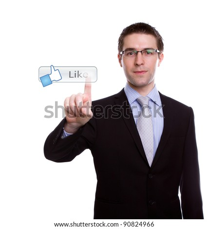 Business man pushing a Like button on a touch screen interface - stock photo