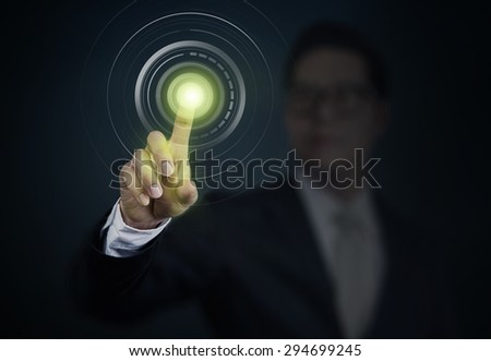 Business Man pushing a power button on touch screen interface. Business, technology, internet and networking  concept. - stock photo