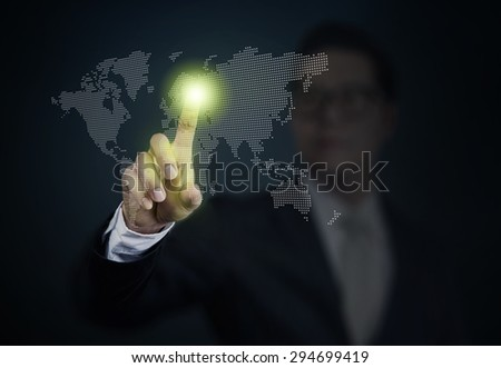 Business Man pushing a world on touch screen interface. Business, technology, internet and networking concept. - stock photo