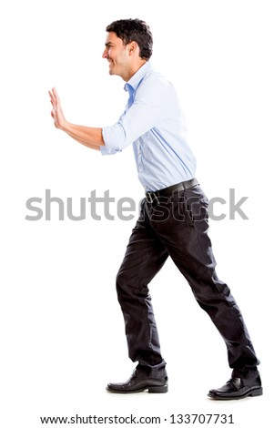Business man pushing imaginary object - isolated over a white background - stock photo