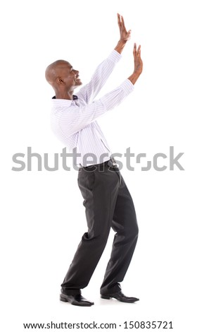 Business man pushing imaginary object with hands - isolated over white
