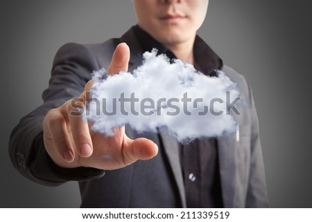 Business Man pushing on a cloud interface