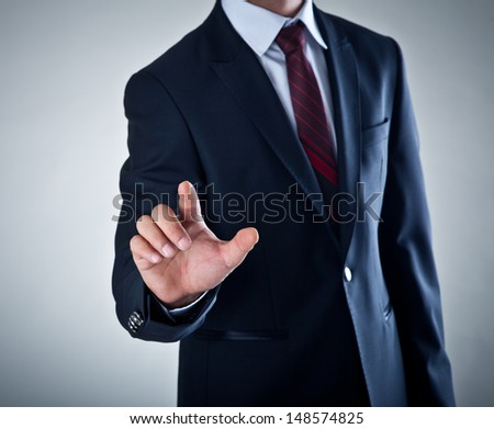 Business Man pushing on a touch screen - stock photo