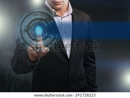 Business Man pushing on a touch screen interface. Business, technology, internet and networking concept. - stock photo