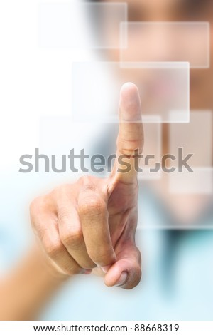 Business man pushing on touch screen icon - stock photo
