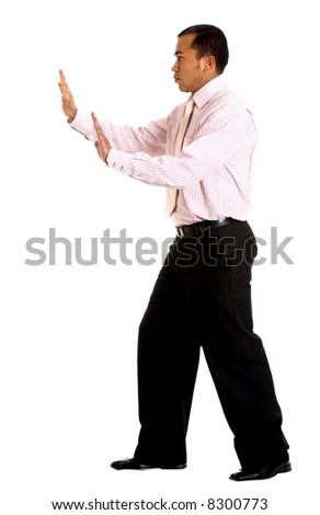 business man pushing something aside isolated over a white background