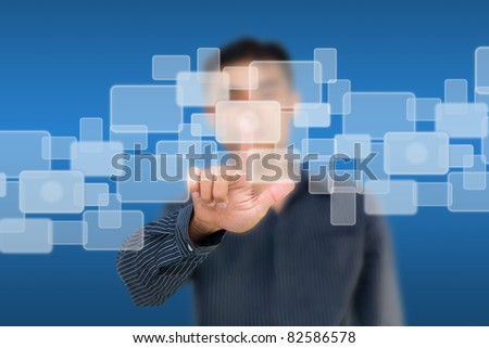 Business man pushing white touch screen icons