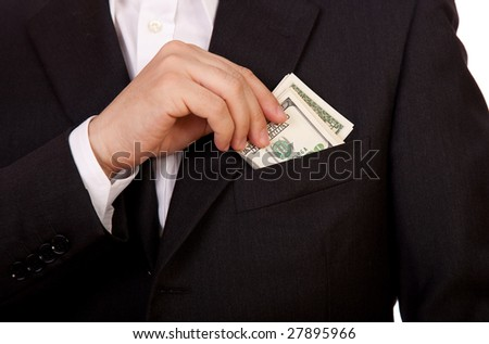 Business man put money in his pocket isolated on white - stock photo