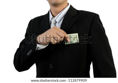 Business man putting money into pocket - stock photo