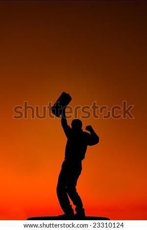 Business man raising fist in air - stock photo