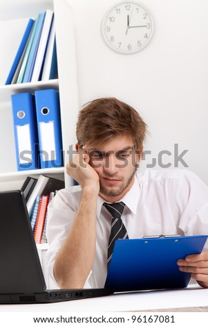 business man read document, contract, hold in hands and looking at clipboard, businessman sitting at the desk, at office - stock photo