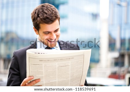 Business man reading a newspaper - stock photo