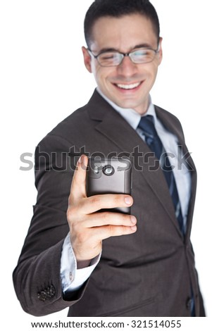 Business man reading text message on cell phone - stock photo