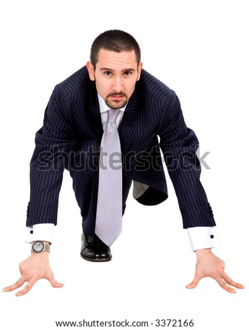 Business man ready to race - isolated over a white background