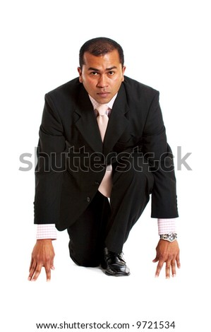 business man ready to race isolated over a white background - stock photo