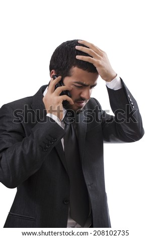 Business man receiving bad news on the cell phone. Isolated with clipping path. - stock photo