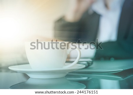Business man relaxing after working and drinking coffee
