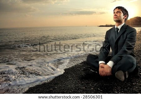 business man relaxing in an enchanting seascape - stock photo
