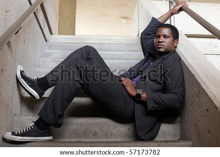 Business Man relaxing in Stairwell - stock photo