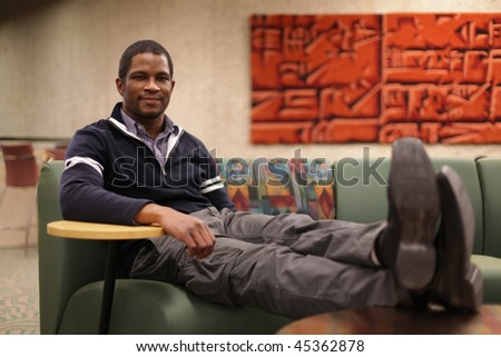 Business Man relaxing with feet up - stock photo