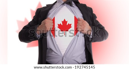 Business man rips open his shirt to show his Canadian flag t-shirt - stock photo