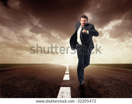 business man running isolated on the road - stock photo