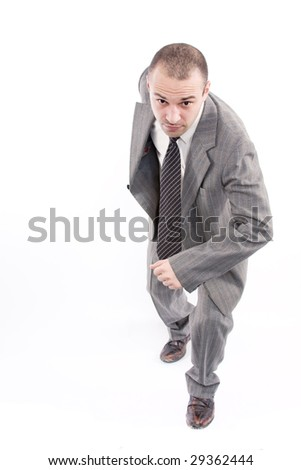 Business man running over a white background - stock photo