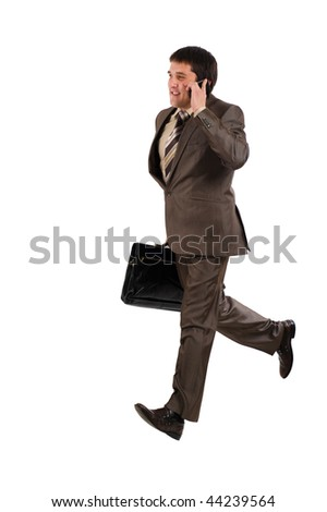 Business man running with a briefcase and speaking by phone, isolated over white background - stock photo