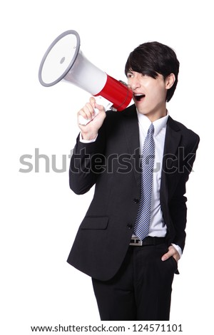 Business man screaming loudly in a megaphone isolated on white background, model is a asian male