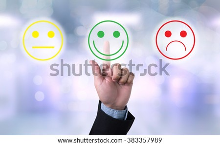 business man select happy on satisfaction evaluation?  on blurred city background - stock photo