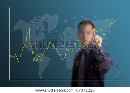 business man selecting to point at fluctuate upward trend graph on world map - stock photo