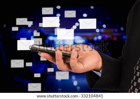 Business man sending email