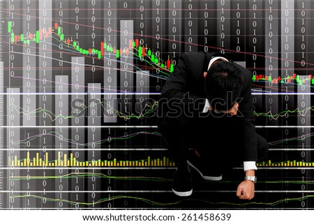 Business man serious a falling down graph of stock market - stock photo