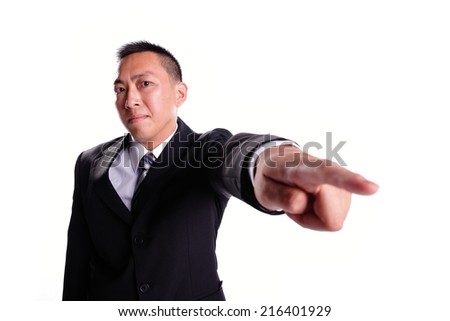 Business man serious pointing by finger isolated on white background, asian - stock photo