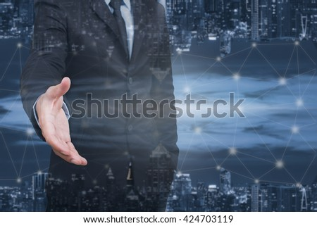 business man shaking hands and city scape double exposure,business