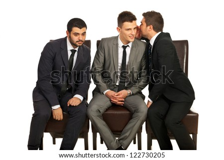 Business man sharing a secret to his colleague and the other trying to hear isolated on white background - stock photo