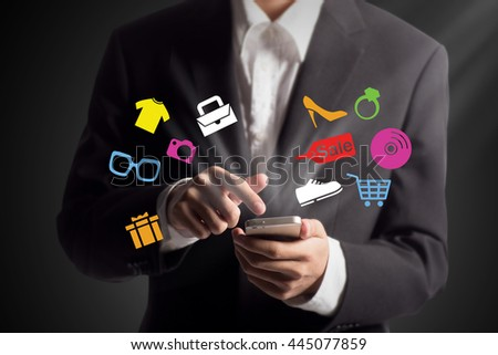 Business man shopping online using his mobile phone - stock photo