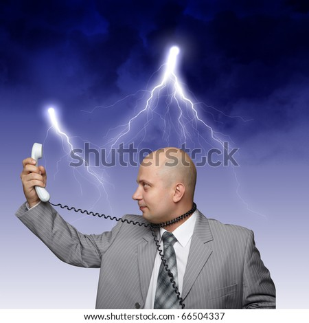 business man shouting out loudly at the phone