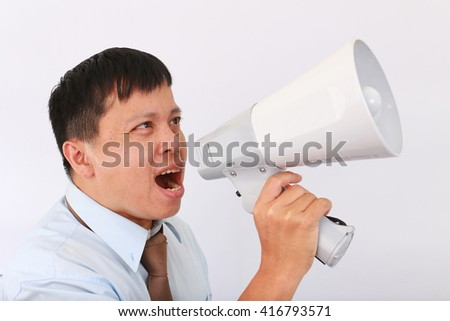 Business man shouts in a white loudspeaker against white background