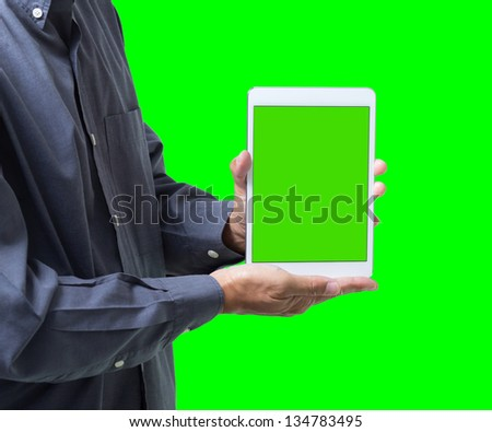 Business man show tablet with green screen on hand, isolated on green background - stock photo