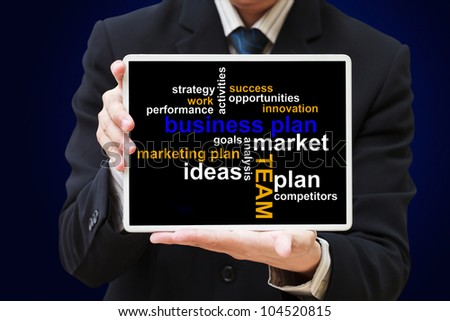 Business man show touch screen tablet with business plan chart - stock photo