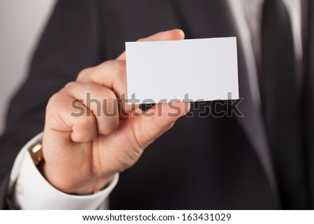 Business man show white card