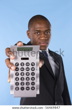 Business man showing a silver calculator - stock photo